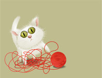 Little cat playing with ball of wool Stock Photo