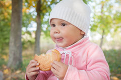Little Caucasian baby girl in autumn park Royalty Free Stock Images