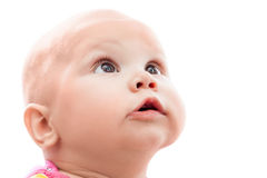 Little Caucasian baby surprise looking up Stock Photo