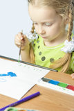 Little caucasian blond girl drawing Stock Image