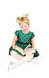 Little caucasian blonde girl reading a book Royalty Free Stock Image