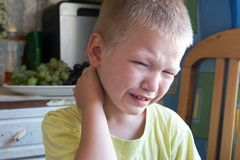 A little Caucasian boy crying with tears. Relations in the family.  Stock Image