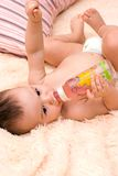 Little caucasian boy drinking from the bottle Royalty Free Stock Photo