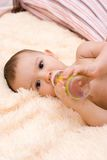 Little caucasian boy drinking from the bottle Stock Images