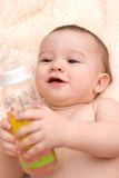 Little caucasian boy drinking from the bottle Stock Image