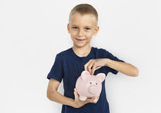 Little Caucasian Boy Holding Piggybank Royalty Free Stock Photography