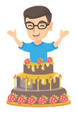 Little caucasian boy jumping out of a large cake. Stock Images