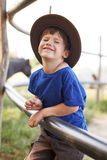 Little caucasian boy laughing on farm Stock Image