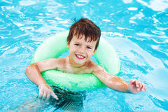 Little caucasian boy learning swim with saver Royalty Free Stock Photography