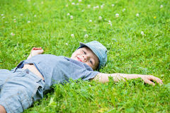 Little caucasian boy resting on grass Royalty Free Stock Photo