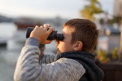 Little boy looking into distance by binoculars Stock Images