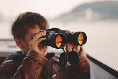 Little boy watching, looking, gazing, searching for by binocular Royalty Free Stock Photos