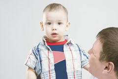 Little Caucasian Child together with his father Royalty Free Stock Image