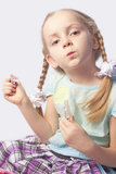 Little caucasian fashionable girl with cosmetics Royalty Free Stock Photos