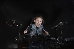 Little caucasian girl drummer play the elettronic drum kit Stock Photo