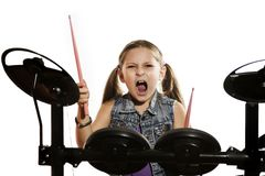 Little caucasian girl drummer playing the elettronic drum kit, close-up photo on white background. Little caucasian girl drummer playing the elettronic drum kit stock image