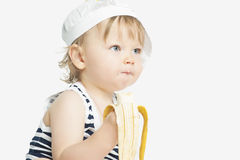 Little caucasian girl eating banana Royalty Free Stock Images