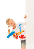 Little Caucasian girl leans out of wall Stock Images