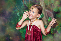 Little caucasian girl in oriental clothing singing Royalty Free Stock Photography