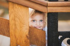 Little caucasian girl palaing hide and seek royalty free stock image