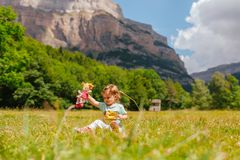 Little girl playing in nature and smiling royalty free stock image