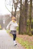 Little caucasian girl running in the park Stock Photo