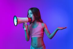 Free Little Caucasian Girl`s Portrait Isolated On Gradient Pink-blue Background In Neon Light. Royalty Free Stock Images - 189679709