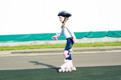 Little caucasian girl skating on track Royalty Free Stock Photography
