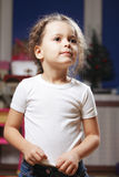 Little girl standing in the room Stock Photography