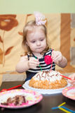 Little girl two ears eating birthday cake Royalty Free Stock Photo