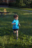 Little caucasian kid run in park stock image