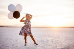 Little girl with baloons on salty lake in Cyprus royalty free stock photos