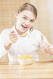 Little Caucasian Teenager Girl Having Cereal Breakfast with Thum Royalty Free Stock Photos