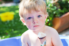 Little caucasian toddler boy eating ice cream in cone Stock Photography