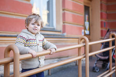 Little caucasian toddler boy having fun, outdoors Royalty Free Stock Photos