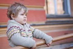Little caucasian toddler boy having fun, outdoors Royalty Free Stock Photography