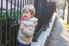 Little caucasian toddler boy having fun, outdoors Royalty Free Stock Image
