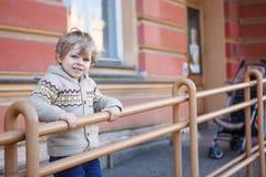 Little caucasian toddler boy having fun, outdoors Stock Photography