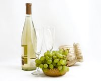 Little celebration for two. White wine,  grapes and two goblets Royalty Free Stock Photography