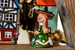 Little ceramic statuette of ginder witch and house in Riga, Latvia 2019 stock photos