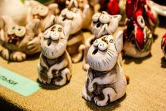Little ceramic whistles of cats in Riga, Latvia 2019 royalty free stock photo