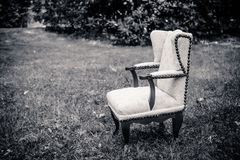 A little chair in the meadow. In black and white Stock Image