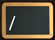 Little chalkboard. Image of little blackboard and chalk on black background royalty free stock image