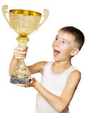 Little champion. Portrait of an excited little champion with his trophy isolated against white background stock photos