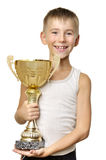 Little champion. Portrait of an excited little champion with his trophy isolated against white background royalty free stock image