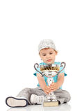 Little champion with his trophy Stock Images