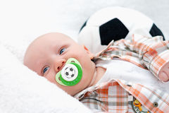 Little chap with a pacifier Stock Image