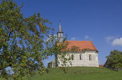 Little chapel on the hill, apple tree, rural landscape Royalty Free Stock Images