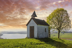 Little chapel on the hill, view to lake riegsee, bavaria Royalty Free Stock Photography