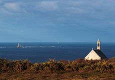 Little chapel and lighthouse at Pointe du Van Royalty Free Stock Images